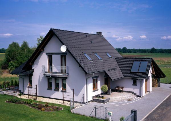 Płaskie dachówki – moda na ciemne dachy